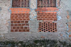 Some windows walled with bricks. Some windows walled with red bricks Royalty Free Stock Photos