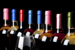 Some wine bottles and a wineglass Royalty Free Stock Photo