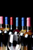 Some wine bottles and a wineglass Stock Images