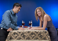 Some wine and fun. Couple drinking wine and having fun in night club or restaurant setting. Male model young in his 20's with mature woman in her 40s stock photo