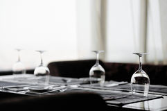 Some wine glasses. On a table stock image