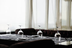 Some wine glasses. On a table stock photography