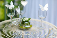 Some wine glasses decorated with butterflies. Some wine glasses decorated with paper butterflies Stock Image