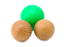 Some wooded souvenirs. Three souvenirs (balls) on a white background. One green sphere is further another royalty free stock photos
