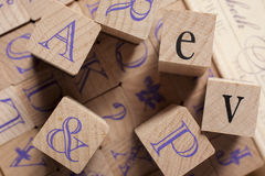 Some wooden alphabet stamps. Wooden alphabet stamps - word letters royalty free stock images