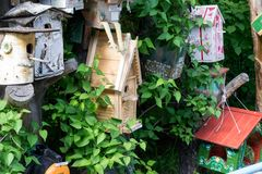 Some wooden birdhouses made by children stock photos