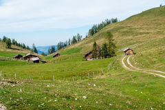 Some wooden huts in the alps. Some traditional wooden huts in the austrian alps stock photo