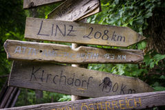 Some wooden waymarker in Austria. With names and distances royalty free stock images