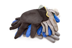 Some work gloves isolated. Different work gloves on a white background, working rubber gloves Royalty Free Stock Images