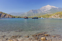 Some yachts in a harbor on mountains background. Some yachts in a harbour on mountains background. Phaselis, Turkey Royalty Free Stock Photography