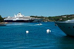 Some yachts moored in Porto Cervo`s marina. View of some yachts moored in Porto Cervo`s marina Royalty Free Stock Image