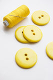 Some yellow big buttons. And thread Stock Photo