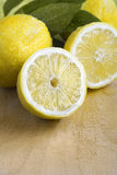 Some yellow fresh lemons. Some yellow, ripe and fresh lemons are on the wood table Royalty Free Stock Photography