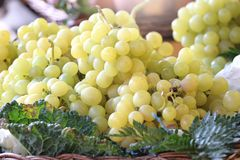 Some yellow grapes in a basket in a street market Royalty Free Stock Photo