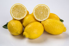 Some yellow lemons over a white background. Fresh fruits royalty free stock photography