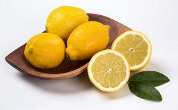 Some yellow lemons over a white background. Fresh fruits royalty free stock photos