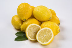 Some yellow lemons over a white background. Fresh fruits stock photos
