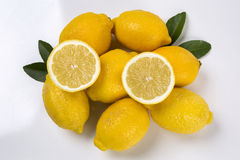 Some yellow lemons over a white background. Fresh fruits stock photography