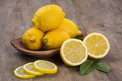 Some yellow lemons over a wooden surface. Fresh fruits stock photos