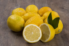 Some yellow lemons over a wooden surface. Stock Image