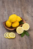 Some yellow lemons over a wooden surface. Fresh fruits stock photo