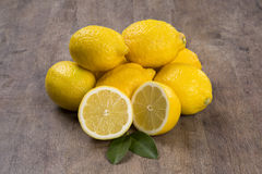 Some yellow lemons over a wooden surface. Royalty Free Stock Photo