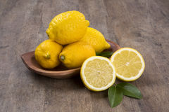 Some yellow lemons over a wooden surface. Fresh fruits stock images