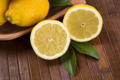 Some yellow lemons over a wooden surface. Stock Photography