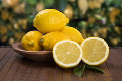 Some yellow lemons over a wooden surface. Fresh fruits stock photography