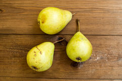Some yellow pears are on the wooden table. There are some yellow pears are on the wooden table stock photography