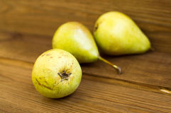 Some yellow pears are on the wooden table. There are some yellow pears are on the wooden table stock image