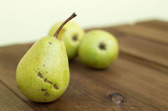 Some yellow pears are on the wooden table. There are some yellow pears are on the wooden table stock photo