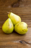 Some yellow pears are on the wooden table. There are some yellow pears are on the wooden table royalty free stock images