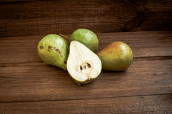 Some yellow pears are on the wooden table. There are some yellow pears are on the wooden table royalty free stock photo