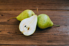 Some yellow pears are on the wooden table. There are some yellow pears are on the wooden table royalty free stock photography