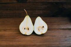 Some yellow pears are on the wooden table. There are some yellow pears are on the wooden table royalty free stock image