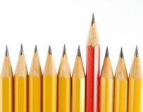 Some yellow pencils and the one red. Some yellow pencils and one red on the white background stock images