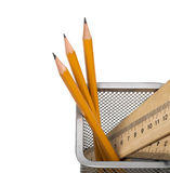 Some yellow pencils and wooden ruler in support Stock Images