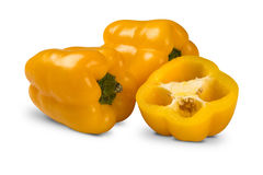 Some yellow peppers over a white background. Fresh vegetable Royalty Free Stock Photo