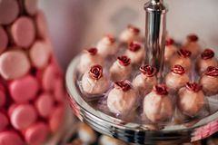 Display of pink chocolate sweets royalty free stock image