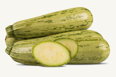 Some zucchinis over a white wooden surface. Fresh vegetable Stock Photo