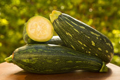 Some zucchinis over a white wooden surface. Fresh vegetable Royalty Free Stock Image