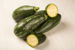 Some zucchinis over a white wooden surface. Fresh vegetable Stock Photography