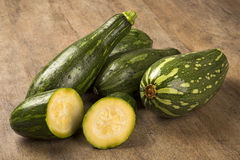 Some zucchinis over a white wooden surface. Fresh vegetable Stock Image