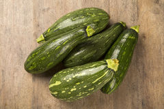 Some zucchinis over a white wooden surface. Fresh vegetable Royalty Free Stock Photography