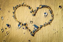 Somebody draws a romantic heart in the sand stock photography
