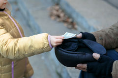 Somebody gives money to the beggar. Getting help. Somebody gives money to a homeless person Stock Images