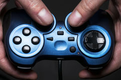 Gamepad. Somebody holding a blue gamepad Stock Photo
