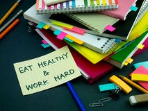Somebody Left the Message on Your Working Desk; Eat Healthy and. Work Hard Royalty Free Stock Photos