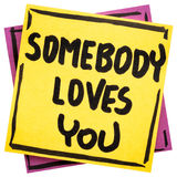 Somebody loves you reminder note Royalty Free Stock Images